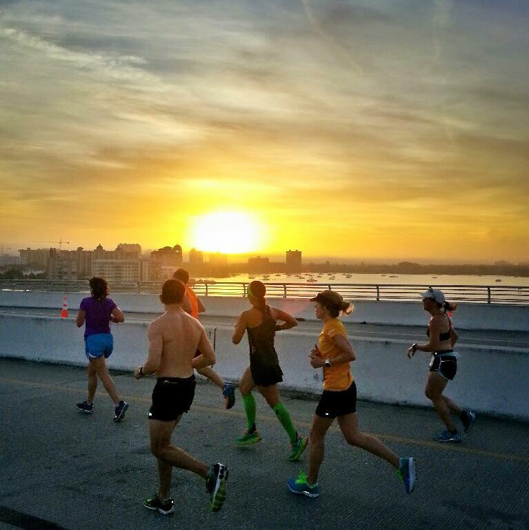 Runners on the John Ringling Causeway Bridge during half marathon race.