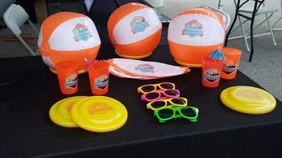 Beach balls, cups, frisbees and sunglasses were given away at the race.