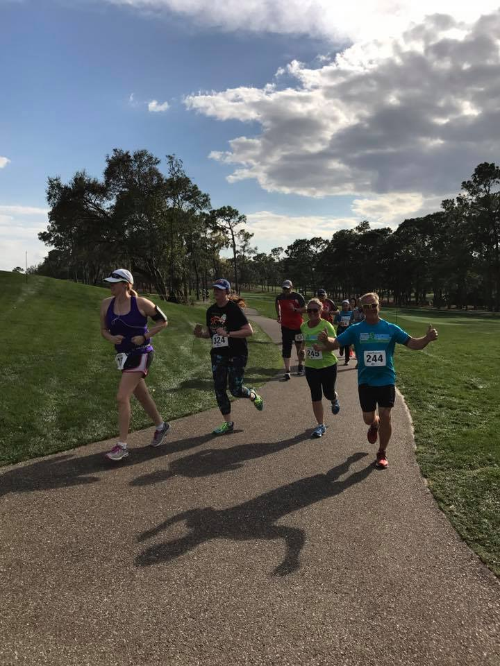 Runners during the Par4Miler race at Innisbrook Golf Resort.