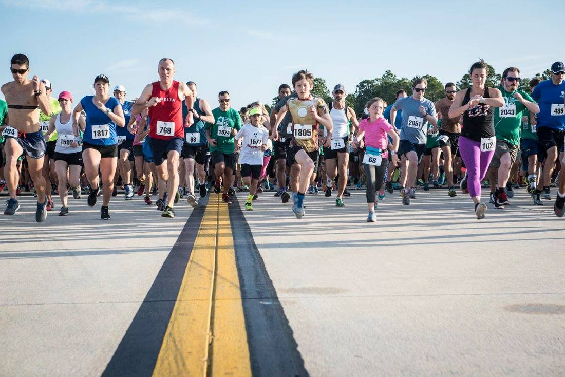 Runners start the 5K on the Runway at Tampa International Airport.