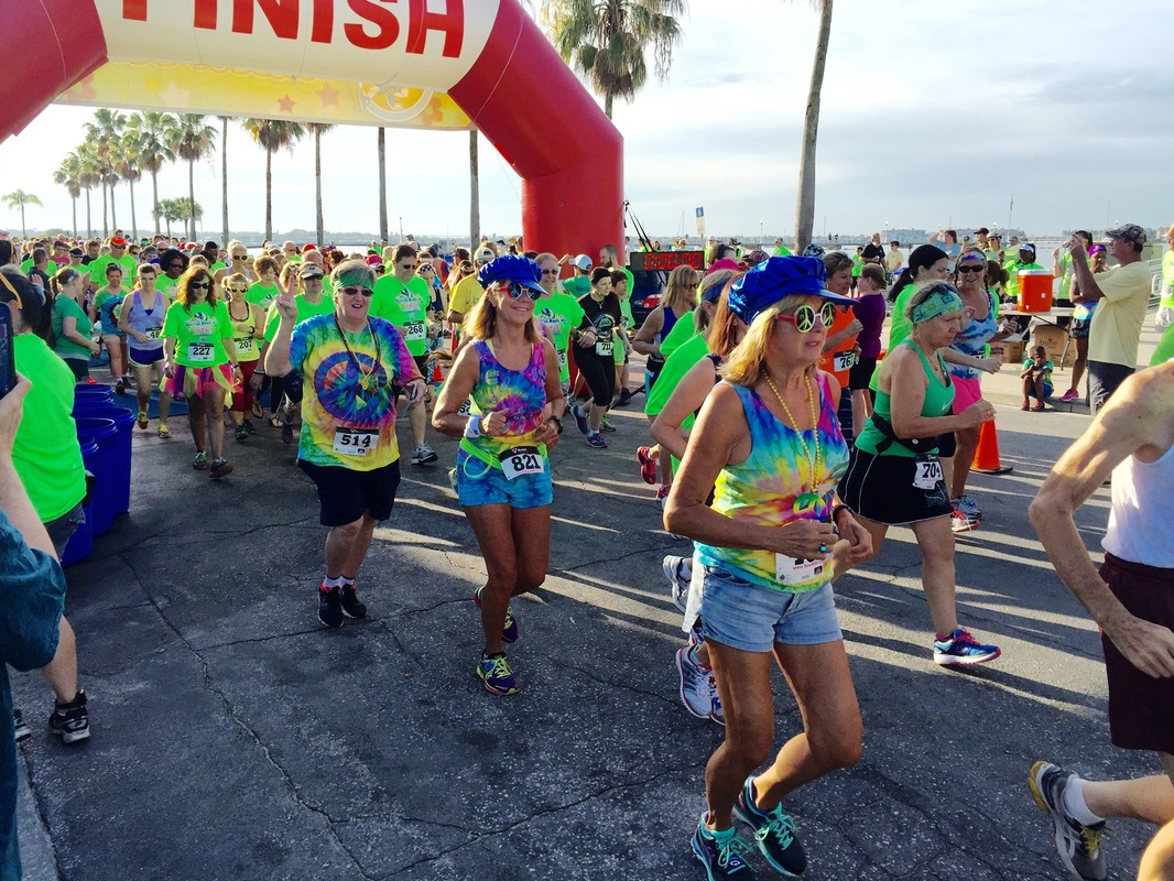 Picture of runners in the Hippie Dash 5k in Gulfport, FL.