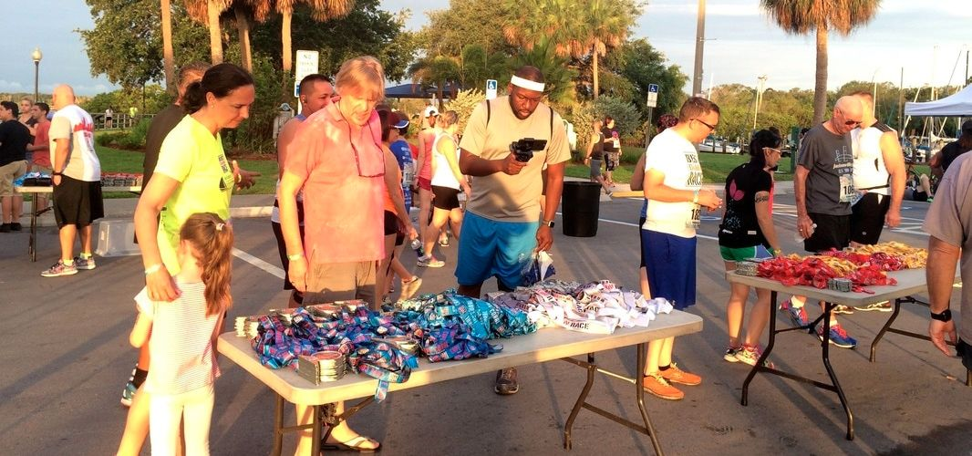 Assorted medals were displayed on tables for the Best Damn Race Leftover 5K Race.