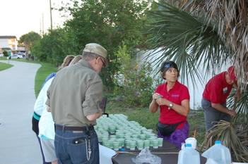Volunteers served water at the 2015 May Day 10K race.