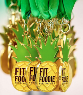 Fit Foodie 5K Medal in shape of a Pineapple.