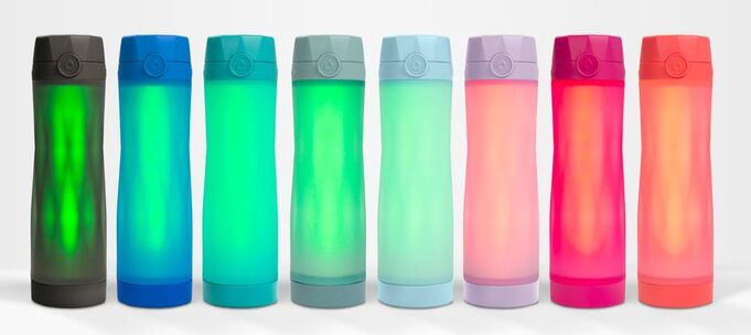 Line up of all the Hidrate Spark 3 water bottle colors. There are 8 colors ranging from black to coral.