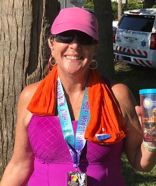 Posing with my medal after the St Pete Run Fest Half Marathon.