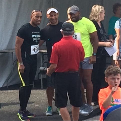 Ronde and Tiki Barber pose before the start of the Par 4 Miler race at Innisbrook Golf Resort in Palm Harber, FL.