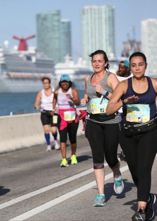 Runners cross MacArthur Causeway in Miami.