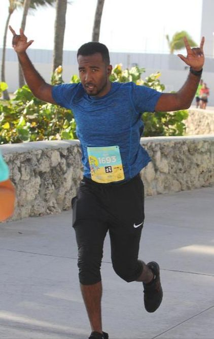 Runner finishes the 305 Half Marathon.