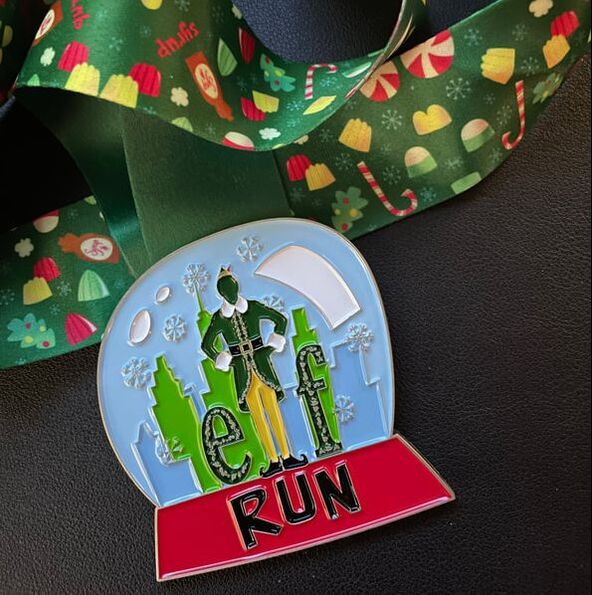 Elf Virtual Run finishers medal.