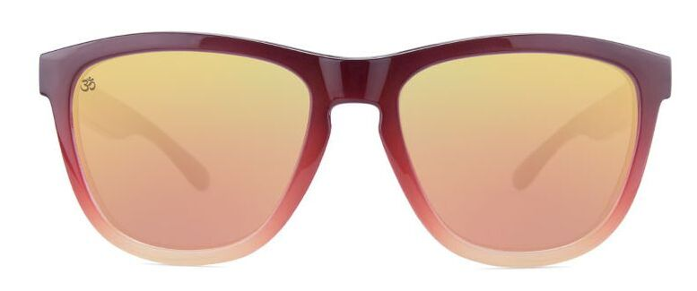 Front view of Namaste sunglasses. Amber frames with rose gold lenses.