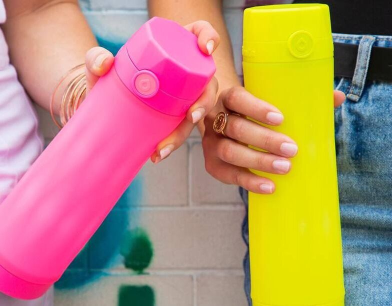 Hot Pink and Volt Yellow Hidrate Spark 3 water bottles.