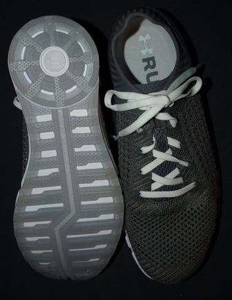top and bottom of UA HOVR Sonic shoe in graphite.