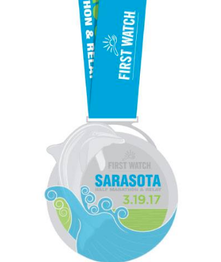 The First Watch Sarasota Half and Relay is known for its giant dolphin medals.