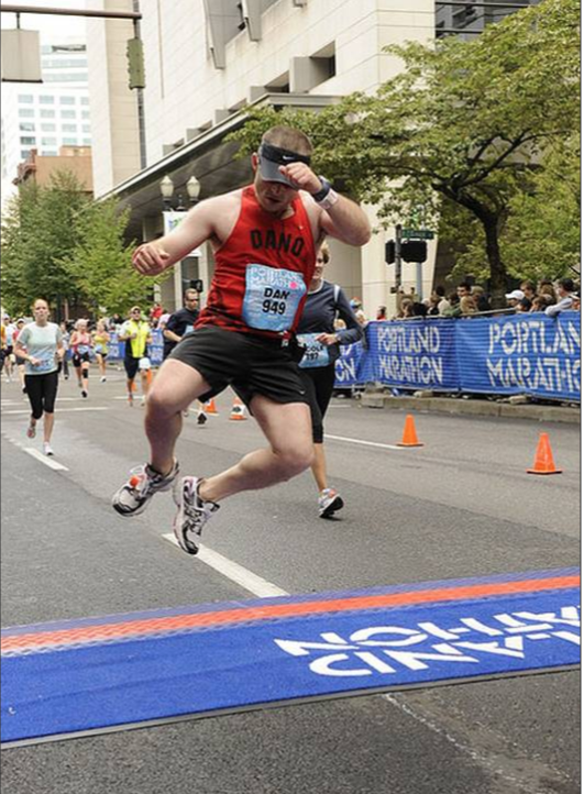 Runner clicks heels at finish line.