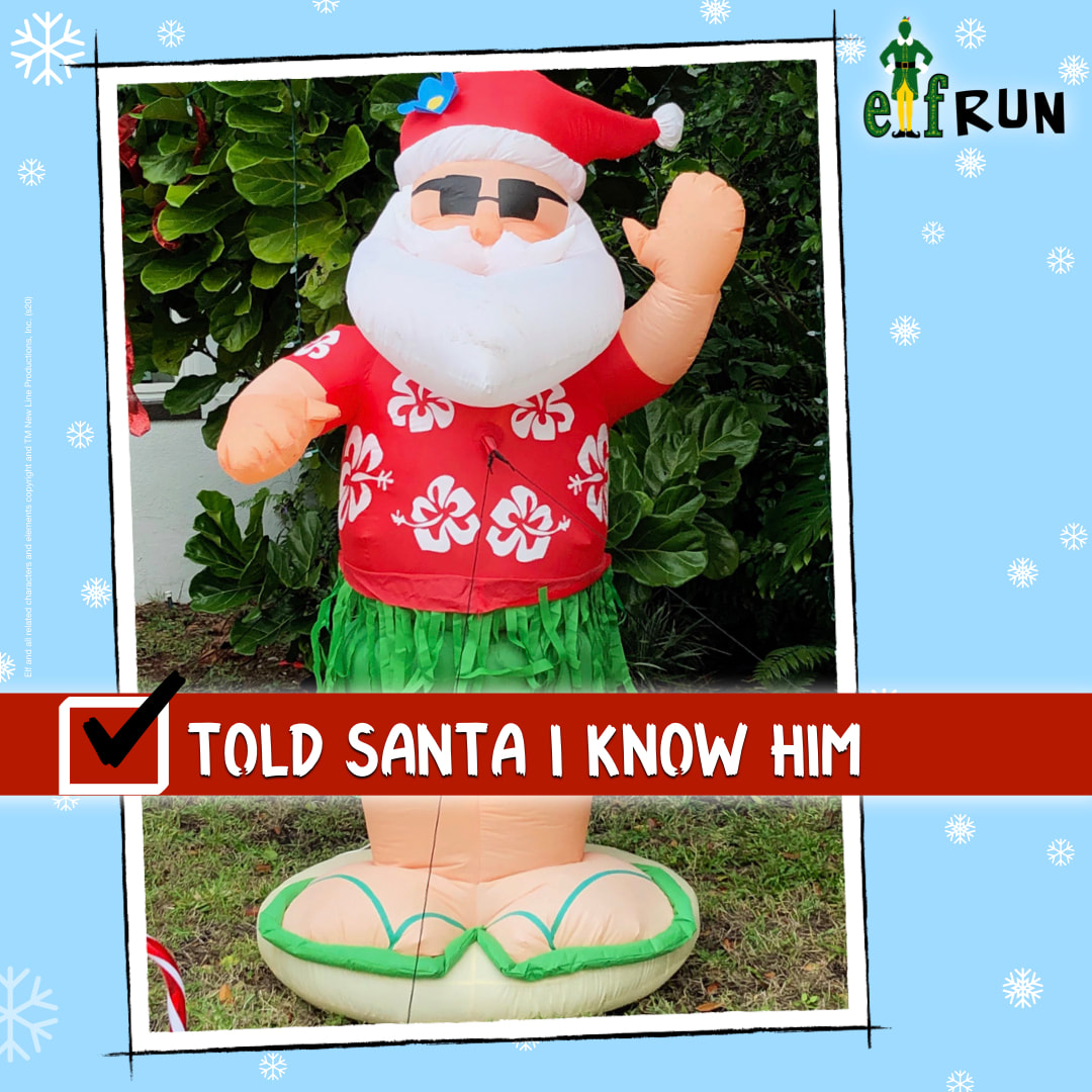 Inflatable Santa in Hawaiian shirt and flip flops.