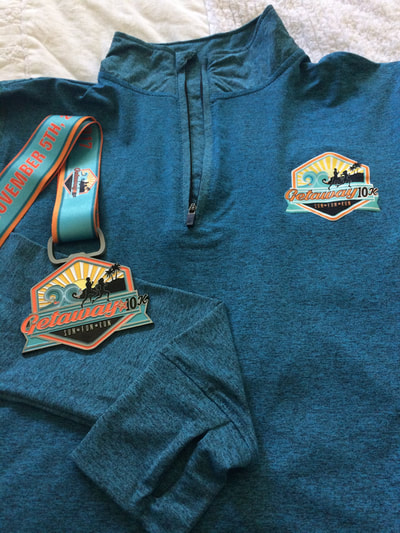 Medal and pullover for #Getaway10K runners.