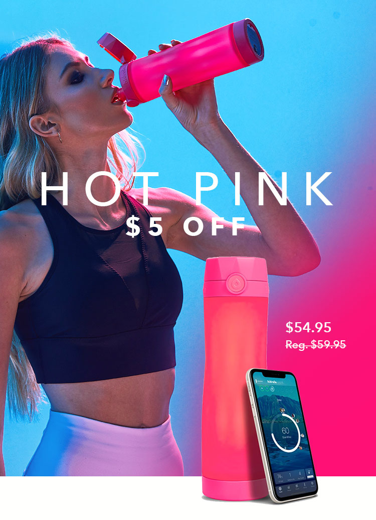 Woman drinking water from a Hidrate Spark 3 smart water bottle that's hot pink color.