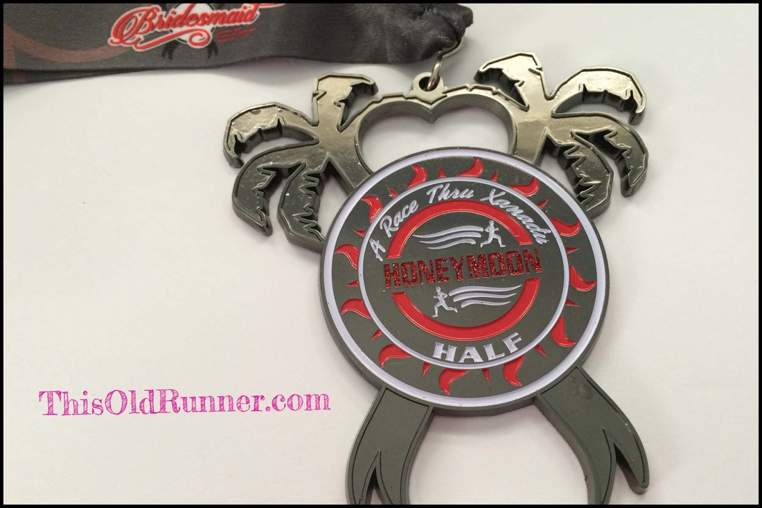Finisher Medal for 2015 Honeymoon Island Half Marathon.