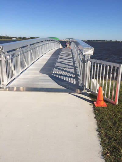 Bridge to walkway across the lake at Nathan Benderson Park in Sarasota, FL.