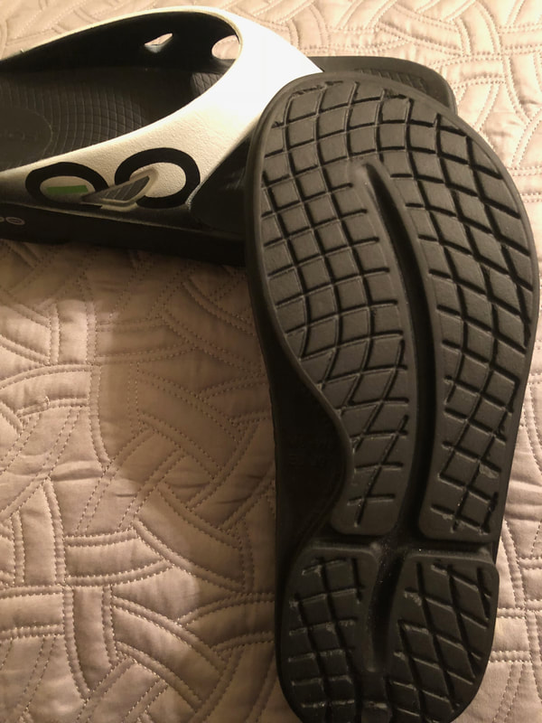 Bottom of Oofos sport sandals showing tread.