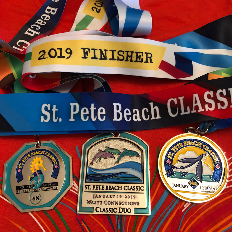 2019 medals from the St Pete Beach Classic 5K and 10K races.