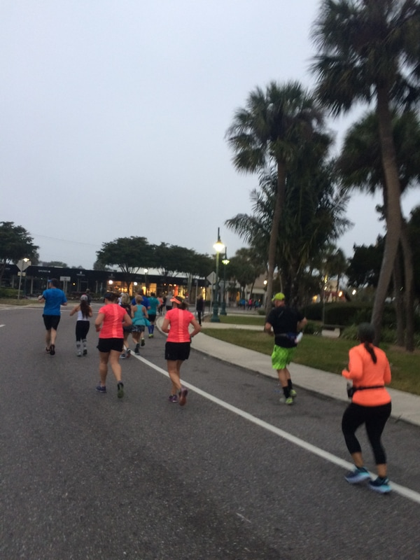Runners in the Sarasota Music Half on St. Armands Circle.