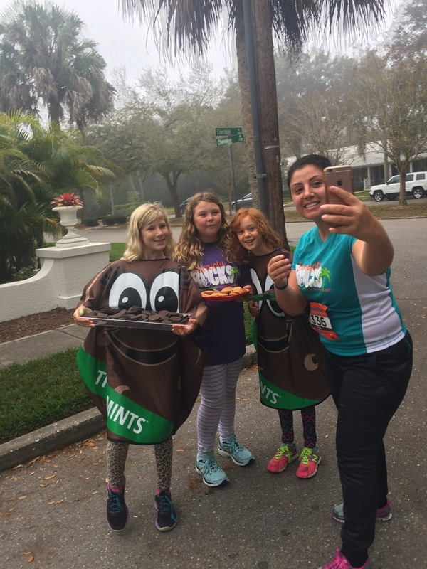 Girl Scouts served cookies and posed for selfies during the 2017 Sarasota Music Half Marathon.