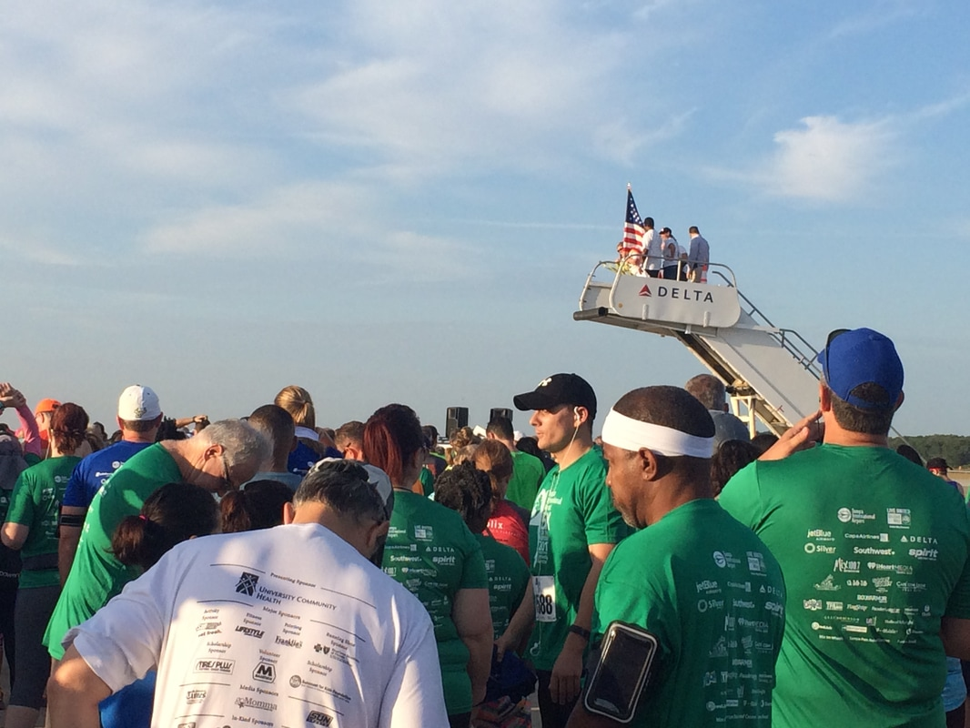 Runners gather at the starting line of the 5K on the Runway at TIA.