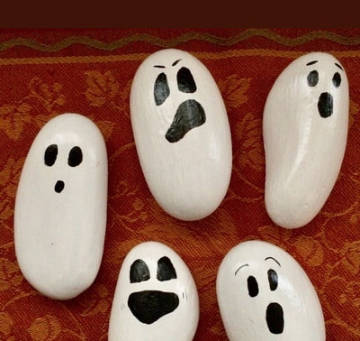 Rocks painted as ghosts.