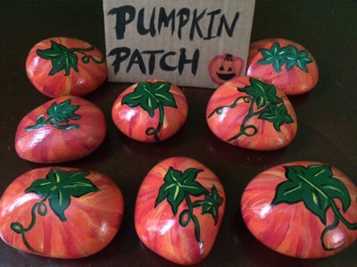 Pumpkin patch of painted rocks.