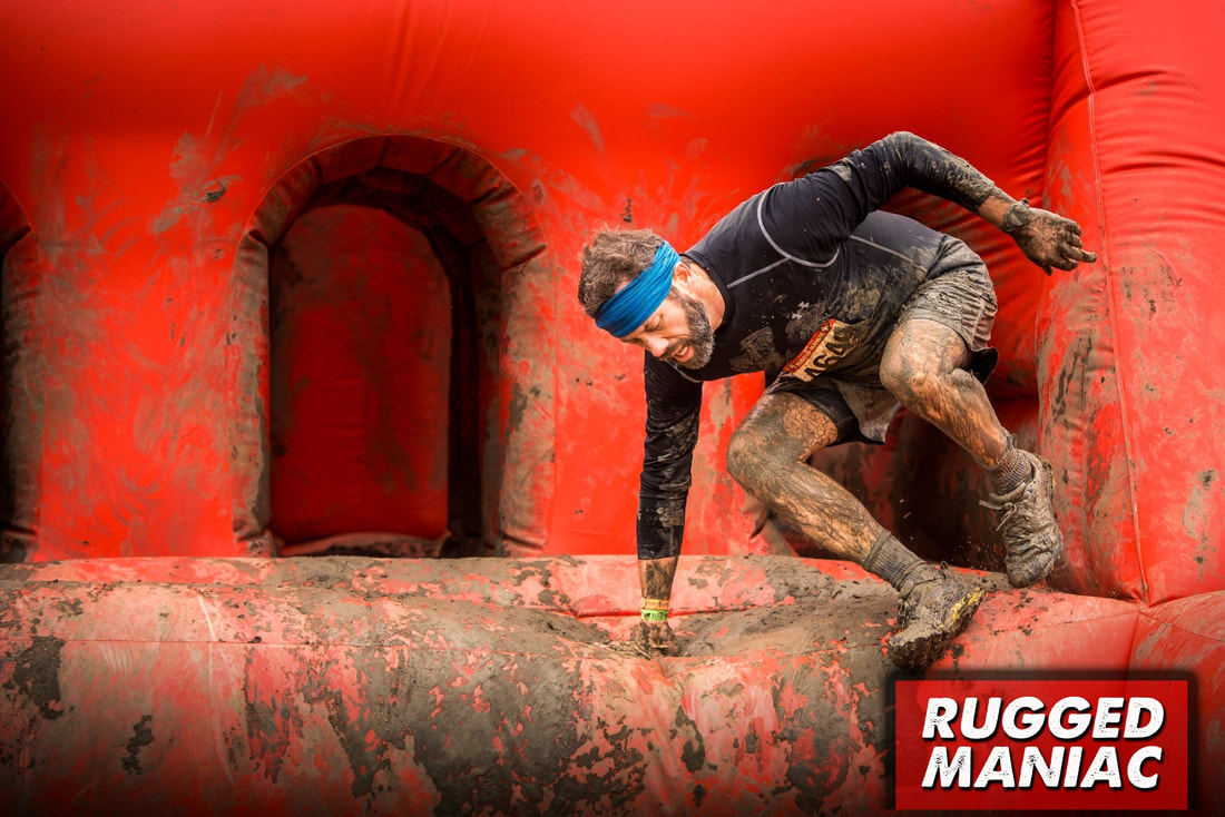 Runner exits Feed the Beast obstacle at Rugged Maniac race.