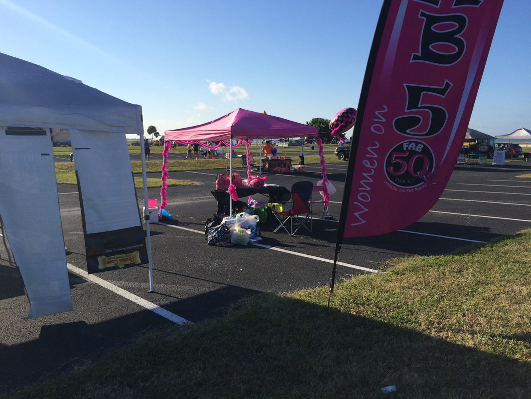 Photo of vendor tents in parking lot at Honeymoon Island Half Marathon.