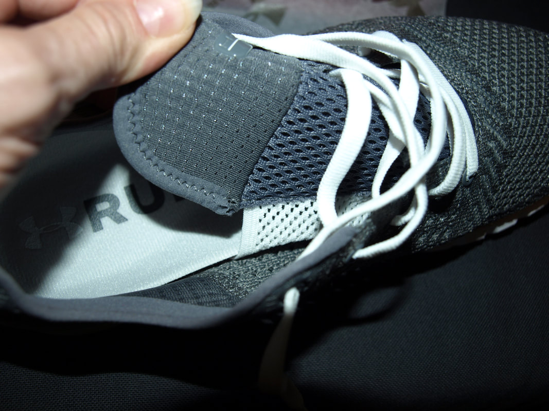 Attached tongue on UA running shoes.