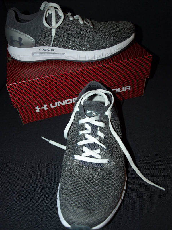 UA Running shoes displayed on box.