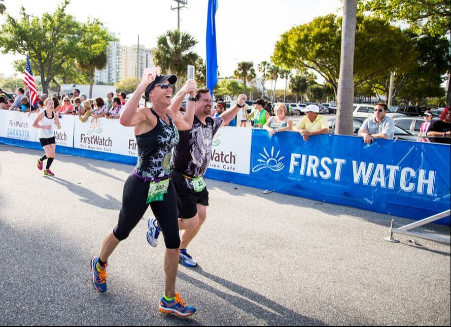 Relay team finishes together at the First Watch Sarasota Half Marathon.