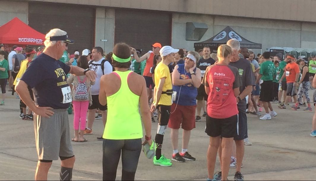 Runners gather on the tarmac near the runway before the 2017 5K on the Runway Race.