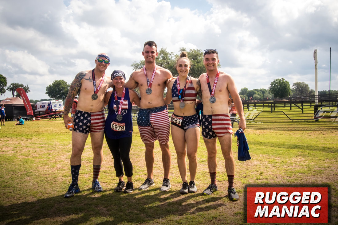 Five people dressed in patriotic gear at Rugged Maniac race.