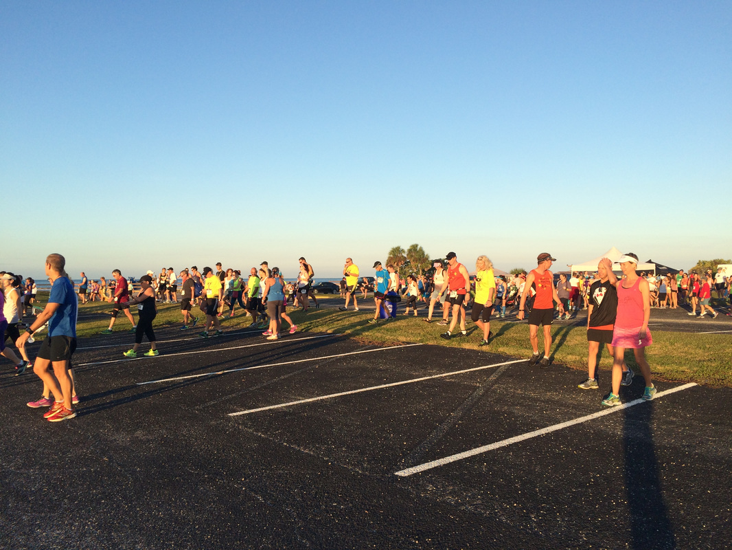 Runners cross the parking lot to the starting line of the Honeymoon Island Half.