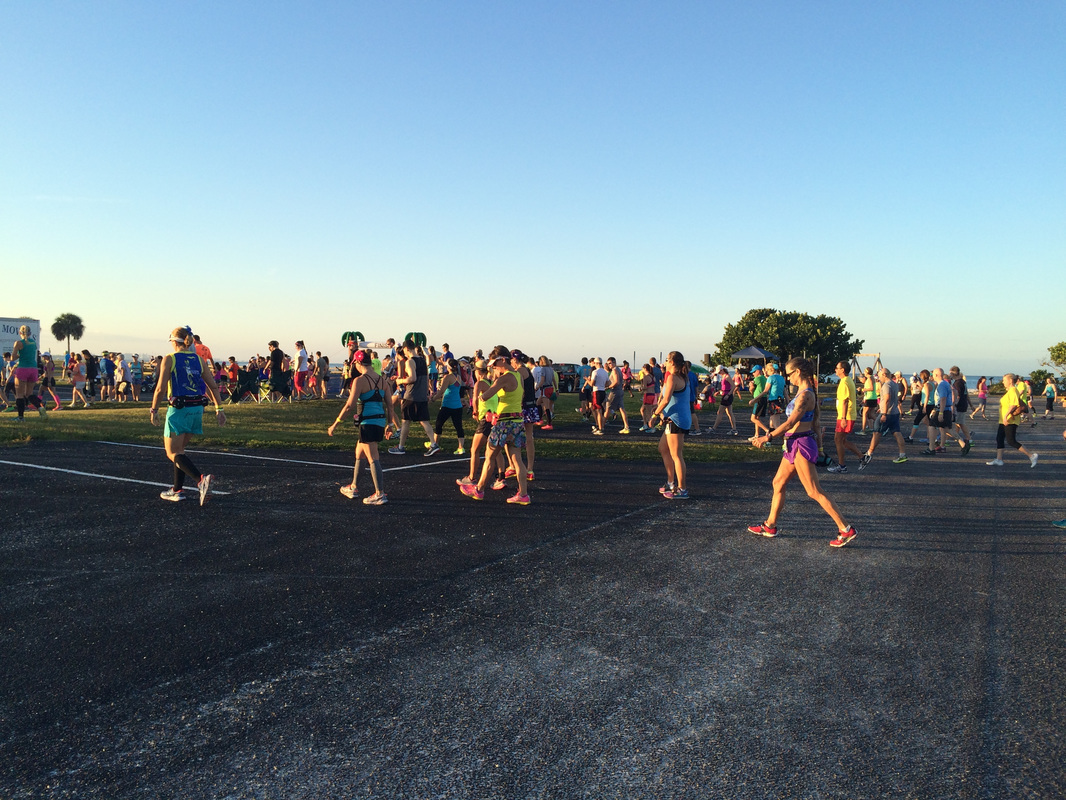 Runners walk across the parking lot at the 2015 Honeymoon Island Half Marathon.