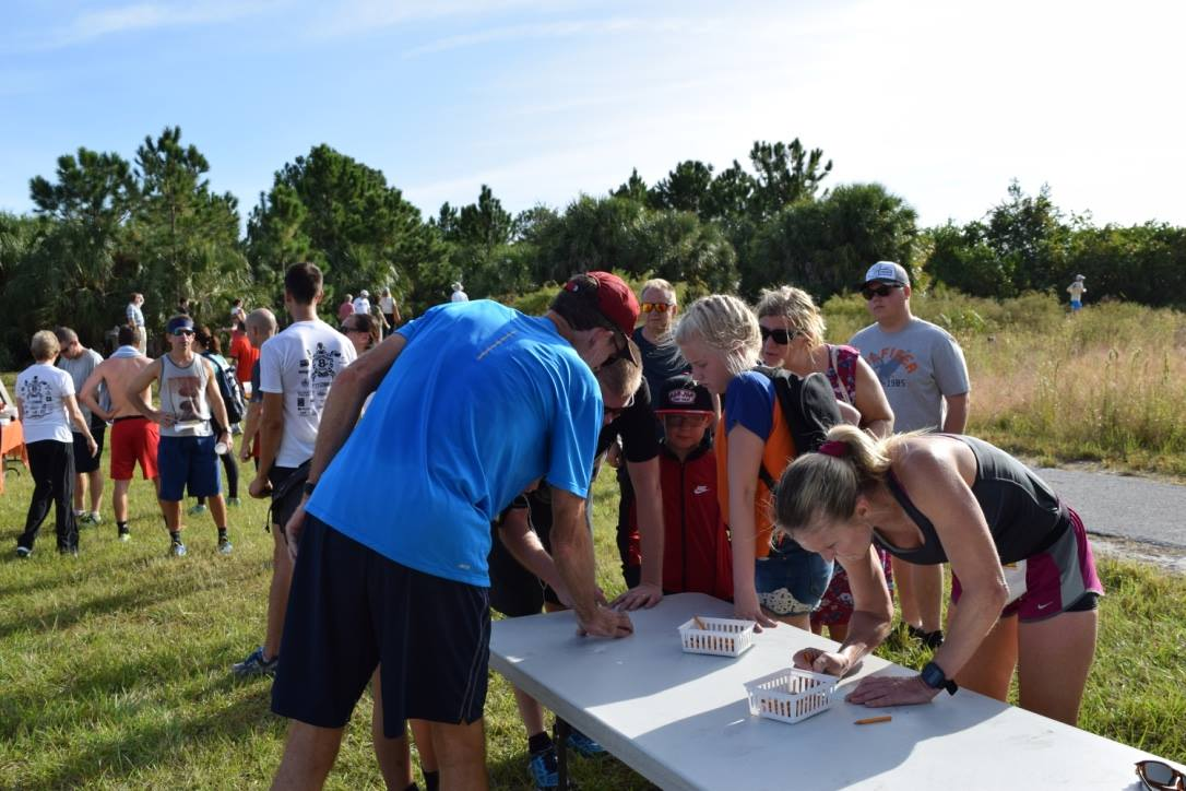 Runners record their times at the Weedon Trail Run
