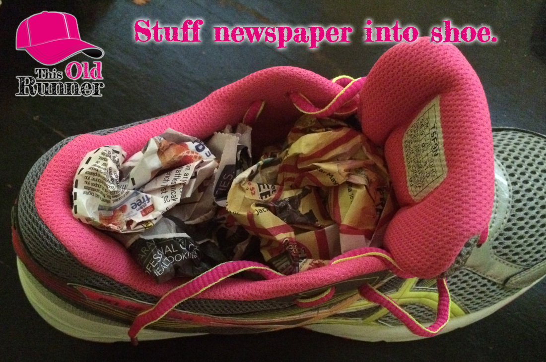 Newspaper stuffed into wet running shoes will absorb the moisture.
