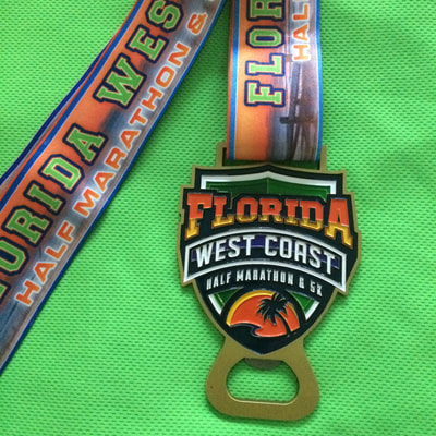 2017 Florida West Coast Half finisher medal.