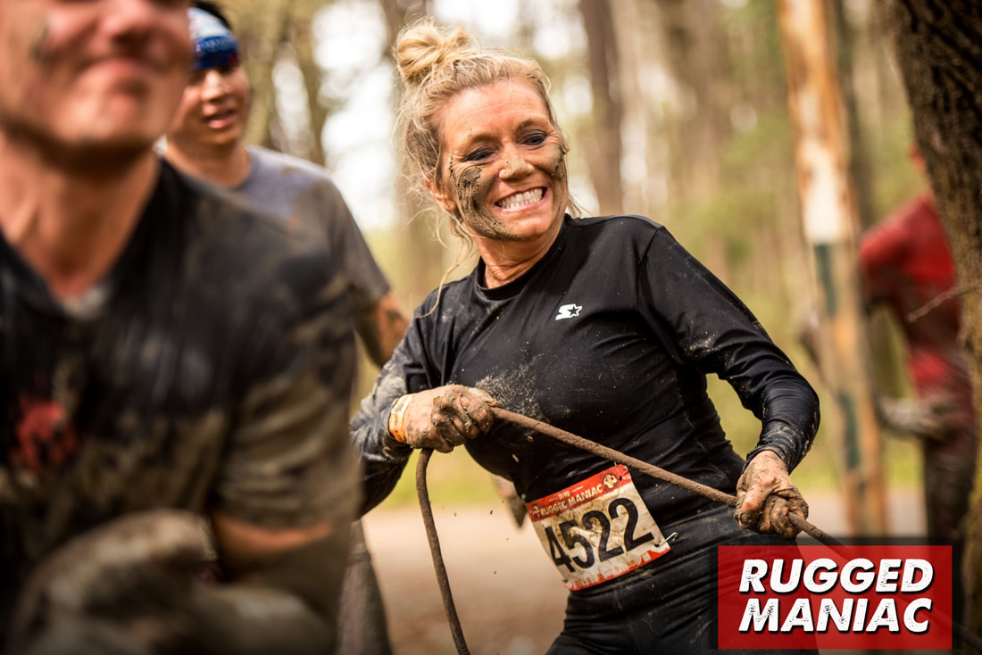 Smiling woman at Rugged Maniac race.